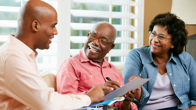 Couple receiving insurance quote from their agent
